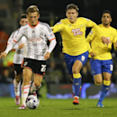 Fulham's George Williams, left, challenges for the ball with Derby's Jeff Hendrick during the English League Cup soccer match between Fulham and Derby County at Craven Cottage stadium in London, Tuesday, Oct. 28, 2014