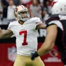 San Francisco 49ers quarterback Colin Kaepernick (7) throws against the Arizona Cardinals during the first half of an NFL football game, Sunday, Sept. 21, 2014, in Glendale, Ariz The Associated Press