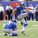 New York Giants kicker Josh Brown (3) follows through on a field goal as punter Steve Weatherford (5) holds against the Houston Texans in the fourth quarter of an NFL football game, Sunday, Sept. 21, 2014, in East Rutherford, N.J The Associated Press