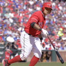 Texas Rangers' Shin-Soo Choo is walked during the seventh inning of an opening day baseball game against the Philadelphia Phillies at Globe Life Park, Monday, March 31, 2014, in Arlington, Texas The Associated Press