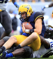 West Virginia quarterback Ford Childress (7) is sacked by Georgia State's Robert Ferguson (10) during the first quarter of an NCAA college football game in Morgantown, W.Va., on Saturday, Sept. 14, 2013. (AP Photo/Christopher Jackson)