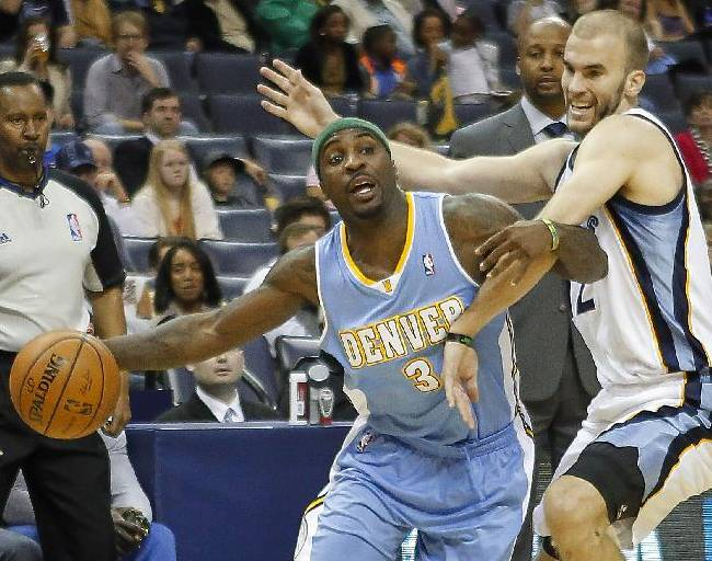 Denver Nuggets guard Ty Lawson (3) tries to get around Memphis Grizzlies guard Nick Calathes in the first half of an NBA basketball game Friday, April 4, 2014, in Memphis, Tenn