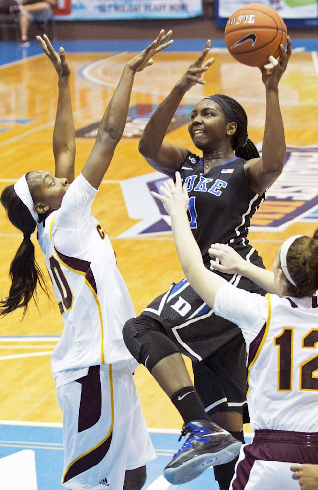 Duke's Elizabeth Williams, center, goes up for a basket against pressure from Central Michigan's Jewel Cotton, left, and Kerby Tamm during the second half of an NCAA college basketball game in St. Thomas, U.S. Virgin Islands, Friday, Nov. 29, 2013. Duke won 97-64