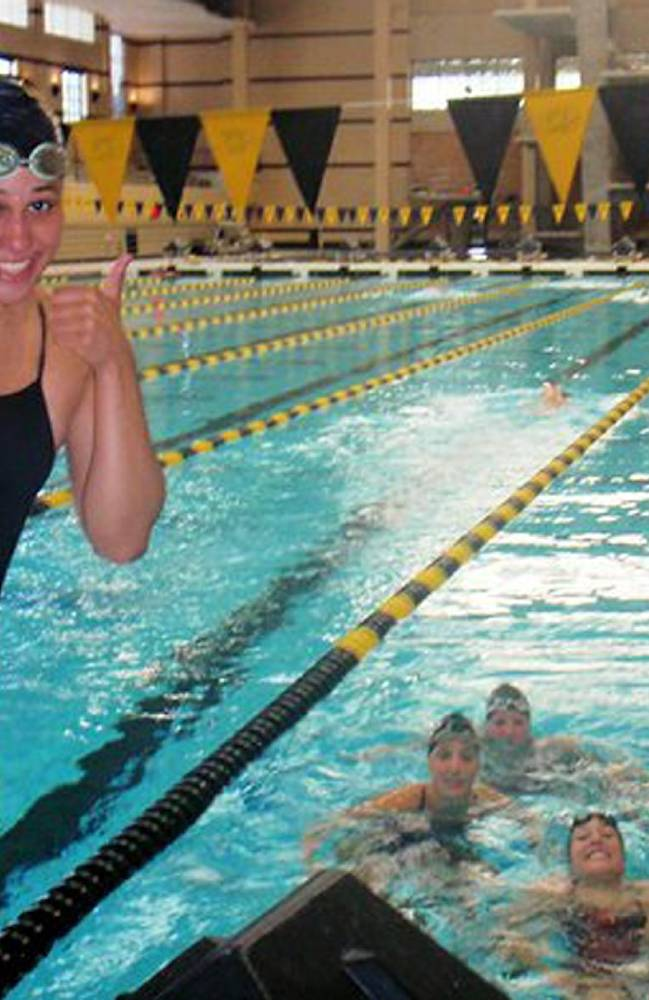 In this photo provided by Mike Menu is his daughter, Sasha Menu Courey, with teammates. The Canadian family of former University of Missouri school swimmer says the school and its athletics department failed to properly investigate her alleged off-campus rape by as many as three football players in 2010. Menu Courey struggled with mental illness and committed suicide 16 months later. (AP Photo/Courtesy Mike Menu)