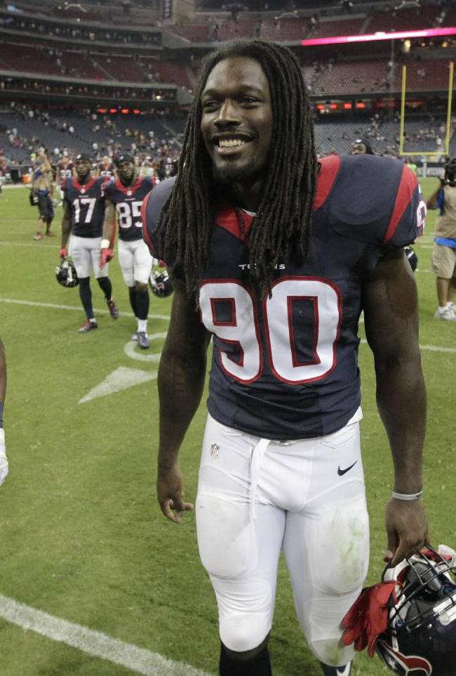 Houston Texans' Jadeveon Clowney (90) and Toben Opurum (42) walk off the field following an NFL preseason football game against the Atlanta Falcons, Saturday, Aug. 16, 2014, in Houston. Houston won 32-7