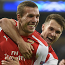Arsenal's Aaron Ramsey, right, hugs teammate Lukas Podolski after Podolski scored 2-1 during the Group D Champions League match between Anderlecht and Arsenal at Constant Vanden Stock Stadium in Brussels, Belgium, Wednesday Oct. 22, 2014