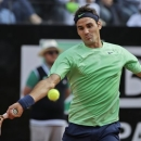 Switzerland's Roger Federer returns the ball to Spain's Rarael Nadal during the final match of the Italian Open tennis tournament in Rome, Sunday, May 19, 2013. Nadal won 6-1, 6-3. (AP Photo/Andrew Medichini)