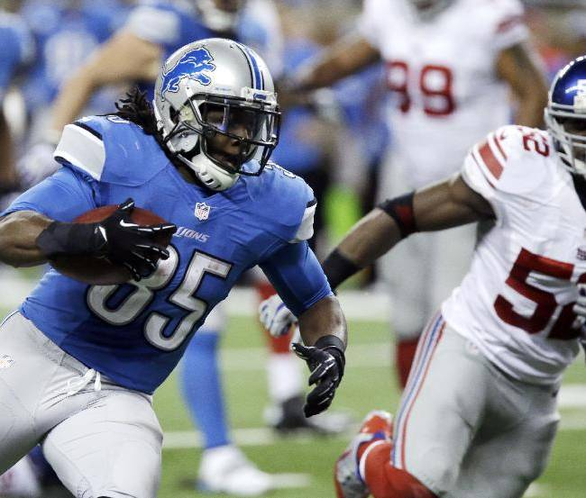Detroit Lions running back Joique Bell (35) is chased by New York Giants middle linebacker Jon Beason (52) during the third quarter of an NFL football game in Detroit, Sunday, Dec. 22, 2013
