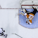 Philadelphia Flyers' Ray Emery, right, cannot block a goal by Los Angeles Kings' Dwight King during the third period of an NHL hockey game, Monday, March 24, 2014, in Philadelphia. Los Angeles won 3-2 The Associated Press