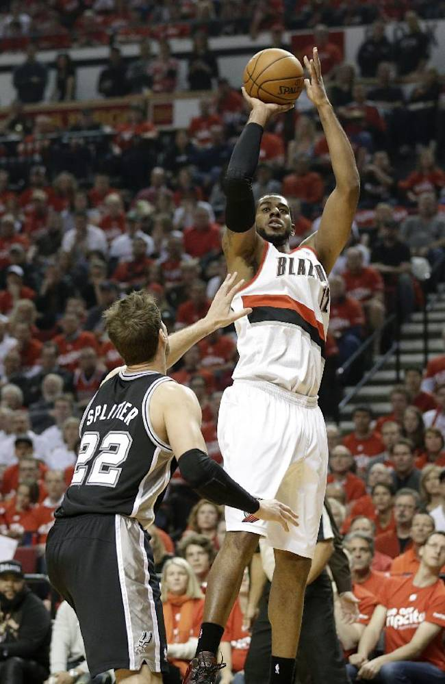 Portland Trail Blazers' LaMarcus Aldridge (12) shoots as San Antonio Spurs' Tiago Splitter (22) looks on in the first quarter during Game 3 of a Western Conference semifinal NBA basketball playoff series Saturday, May 10, 2014, in Portland, Ore
