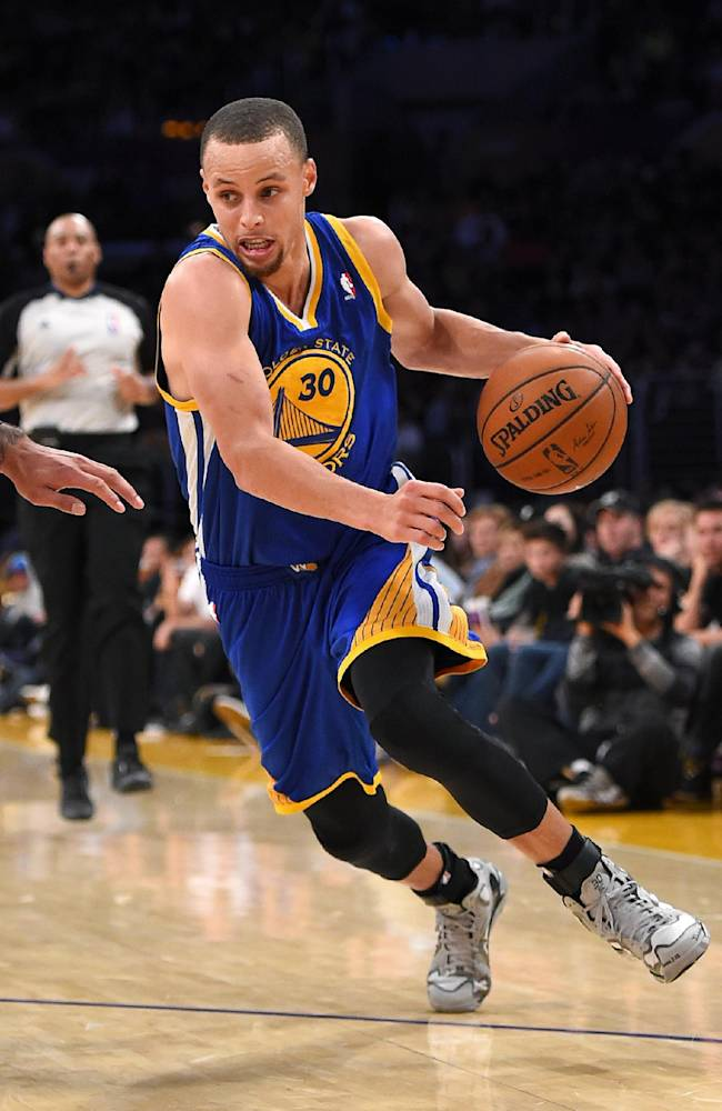 Golden State Warriors guard Stephen Curry drives to the basket during the second half of an NBA basketball game against the Los Angeles Lakers, Friday, April 11, 2014, in Los Angeles. The Warriors won 112-95
