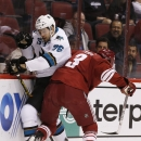 Arizona Coyotes' Keith Yandle (3) checks San Jose Sharks' Eriah Hayes (76) into the boards during the first period of a preseason NHL hockey game Friday, Oct. 3, 2014, in Glendale, Ariz The Associated Press