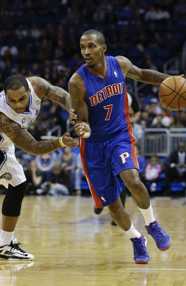 Detroit Pistons' Brandon Jennings (7) drives to the basket past Orlando Magic's Jameer Nelson, left, during the first half of an NBA basketball game in Orlando, Fla., Friday, Dec. 27, 2013