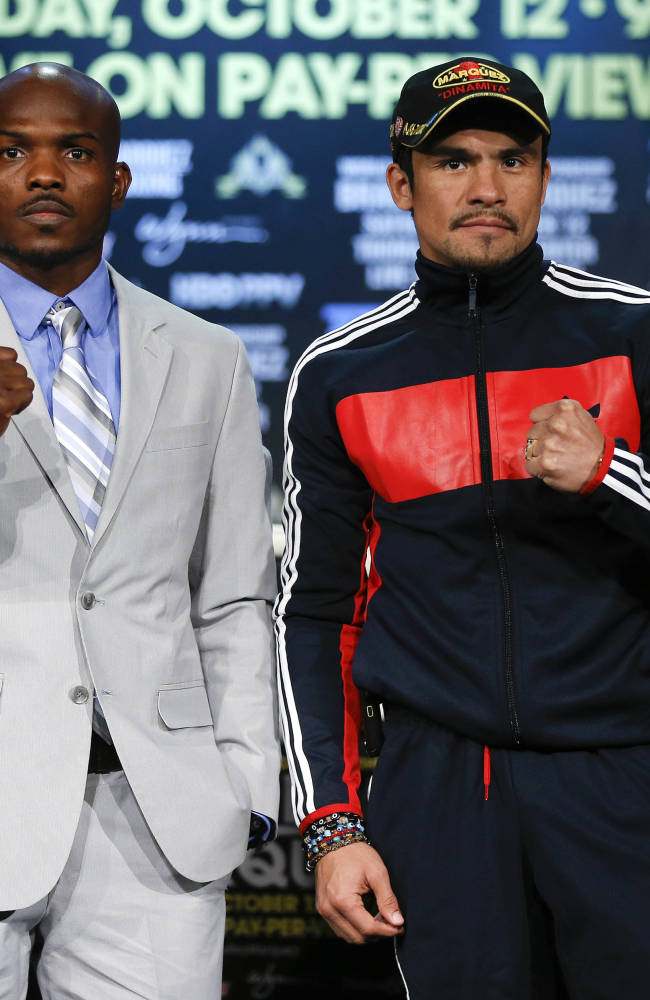 Timothy Bradley, second from left, and Juan Manuel Marquez pose for photos after a news conference, Wednesday, Oct. 9, 2013, in Las Vegas. The two boxers meet Saturday for Bradley's WBO welterweight title