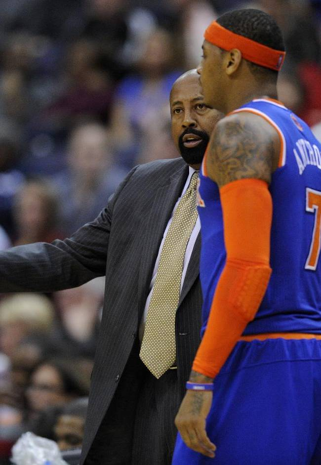 New York Knicks head coach Mike Woodson, left, talks with Carmelo Anthony during the first half of an NBA basketball game against the Washington Wizards, Saturday, Nov. 23, 2013, in Washington