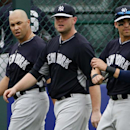 From left, New York Yankees's Carlos Beltran, Brian McCann, and Jacoby Ellsbury walk on the field after an exhibition spring training baseball game against the Pittsburgh Pirates at McKechnie Field in Bradenton, Fla., Wednesday, Feb. 26, 2014 The Associa