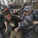 Russian riot police officers detain CSKA Moscow soccer fans after they marched in Moscow, Russia, Saturday, May 18, 2013, celebrating their team' Russian Premier League Championship title. (AP Photo/Denis Tyrin)