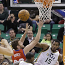 Philadelphia 76ers' Spencer Hawes (00) battles with Utah Jazz's Derrick Favors (15) and Jazz's Marvin Williams (2) for a rebound in the first quarter of an NBA basketball game on Wednesday, Feb. 12, 2014, in Salt Lake City The Associated Press