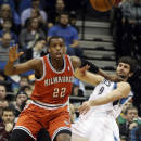Milwaukee Bucks' Khris Middleton, left, shoves Minnesota Timberwolves' Ricky Rubio of Spain as he waits for a pass in the first quarter of an NBA basketball game, Tuesday, March 11, 2014, in Minneapolis. (AP Photo/Jim Mone)