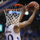 Kansas forward Kevin Young misses a dunk during the first half of an NCAA college basketball game against Temple in Lawrence, Kan., Sunday, Jan. 6, 2013. (AP Photo/Orlin Wagner)