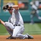 Chicago White Sox third baseman Conor Gillaspie snags a ground ball hit by Los Angeles Angels' Albert Pujols on the start of a double play in the first inning of a baseball game, Saturday, May 18, 2013, in Anaheim, Calif. Mike Trout was out at second, and Pujols at first. (AP Photo/Mark J. Terrill)