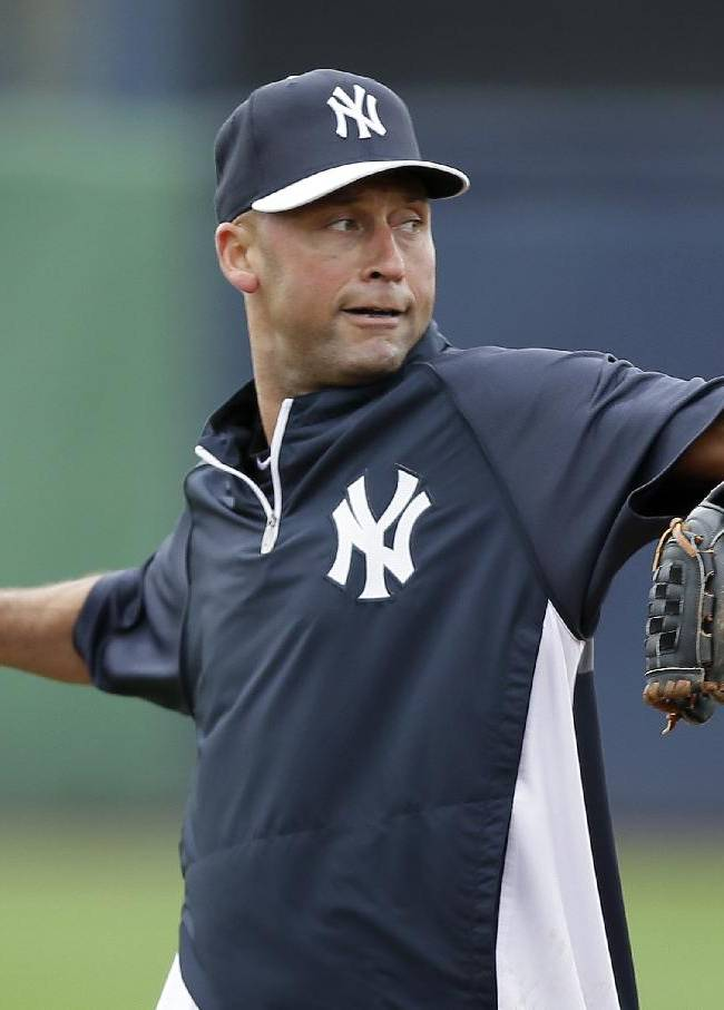 New York Yankees shortstop Derek Jeter warms up before an exhibition baseball game against the Pittsburgh Pirates Thursday, Feb. 27, 2014, in Tampa, Fla