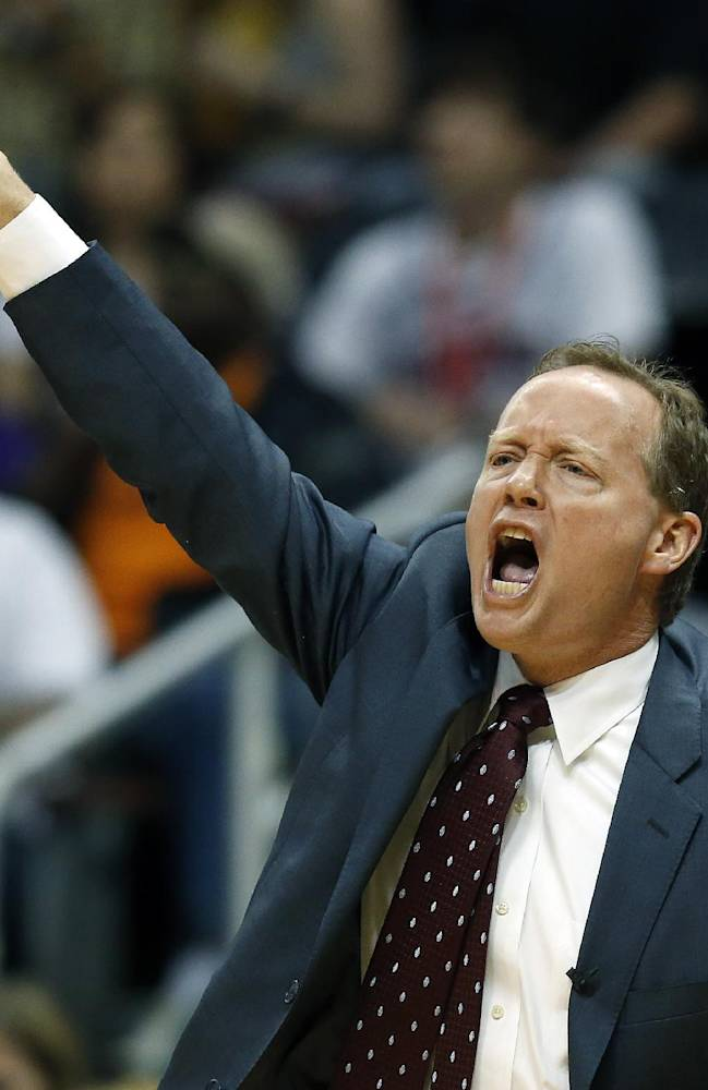 Atlanta Hawks head coach Mike Budenholzer, from the bench, directs his team against the Indiana Pacers in the first  half of Game 4 of an NBA basketball first-round playoff series, Saturday, April 26, 2014, in Atlanta