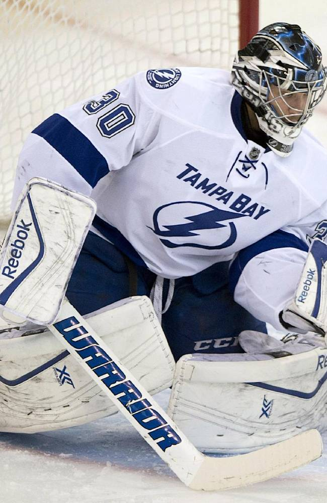 Tampa Bay Lightning goalie Ben Bishop makes a save against the Ottawa Senators during the first period of an NHL hockey game Thursday, March 20, 2014, in Ottawa