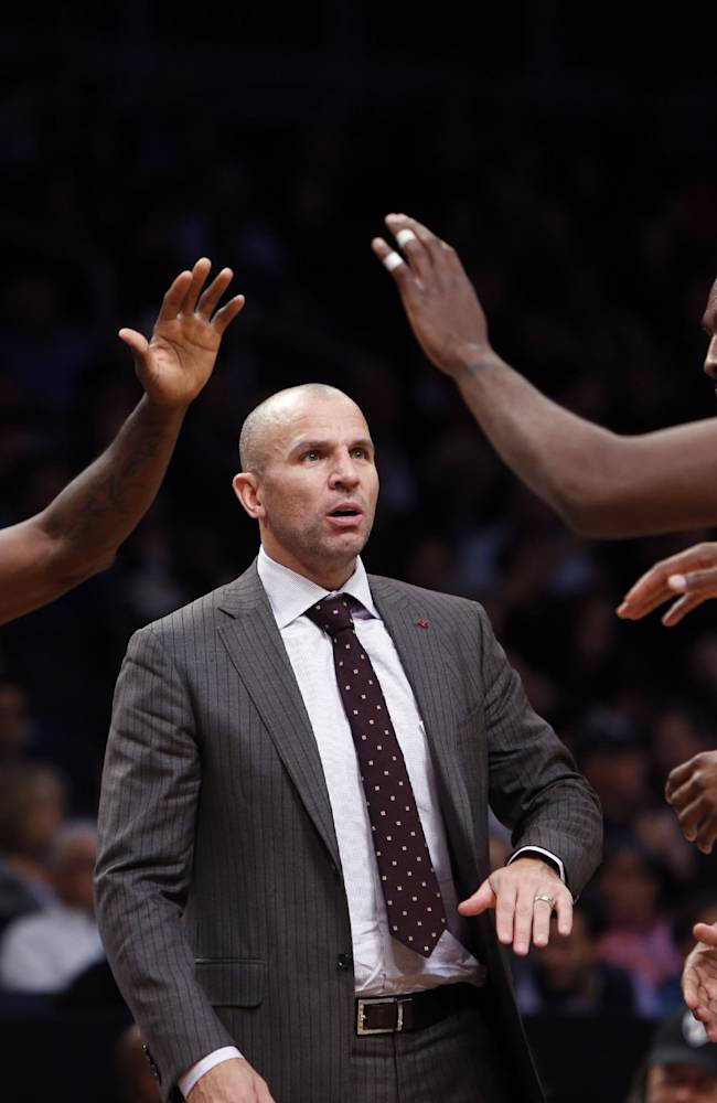 Brooklyn Nets coach Jason Kidd talks with his team during an NBA basketball game against the Utah Jazz on Tuesday, Nov. 5, 2013, in New York. Brooklyn defeated Utah 104-88
