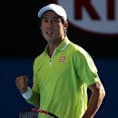 Kei Nishikori of Japan celebrates a point won against David Ferrer of Spain during their fourth round match at the Australian Open tennis championship in Melbourne, Australia, Monday, Jan. 26, 2015. (AP Photo/Rob Griffith)