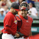 St. Louis Cardinals catcher Tony Cruz, right, celebrates with pitcher Pat Neshek after the Cardinals beat the Minnesota Twins 3-1 in an exhibition spring training baseball game, Wednesday, March 19, 2014, in Jupiter, Fla The Associated Press