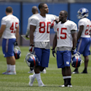 New York Giants' Victor Cruz (80) and Trindon Holliday (15) talk during NFL football camp in East Rutherford, N.J., Tuesday, July 22, 2014 The Associated Press