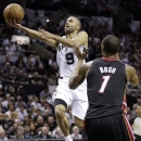 San Antonio Spurs' Tony Parker (9) shoots against Miami Heat's Chris Bosh (1) during the first half at Game 4 of the NBA Finals basketball series, Thursday, June 13, 2013, in San Antonio. (AP Photo/Eric Gay)