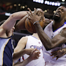 Los Angeles Clippers center DeAndre Jordan, right, and Memphis Grizzlies center Kosta Koufos battle for a loose ball during the first half of an NBA basketball game in Los Angeles, Monday, Nov. 18, 2013 The Associated Press