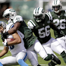 Detroit Lions wide receiver Golden Tate, left, is hit by New York Jets cornerback Darrin Walls (30) as Jets inside linebacker Demario Davis (56) and strong safety Dawan Landry (26) help defend during the first half of an NFL football game, Sunday, Sept. 2