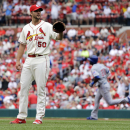 Carpenter, Wainwright help Cardinals top Cubs 10-4 The Associated Press