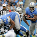 In this Sept. 14, 2014, file photo, Detroit Lions running back Reggie Bush (21) runs the ball during an NFL football game against the Carolina Panthers in Charlotte, N.C. The Lions signed Bush as a free agent before last season and the elusive running ba