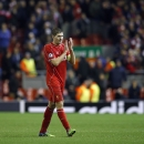 Liverpool's Steven Gerrard leaves the field at the end of the Champions League Group B soccer match between Liverpool and FC Basel at Anfield Stadium in Liverpool, England, Tuesday, Dec. 9, 2014. The match ended 1-1. (AP Photo/Jon Super)