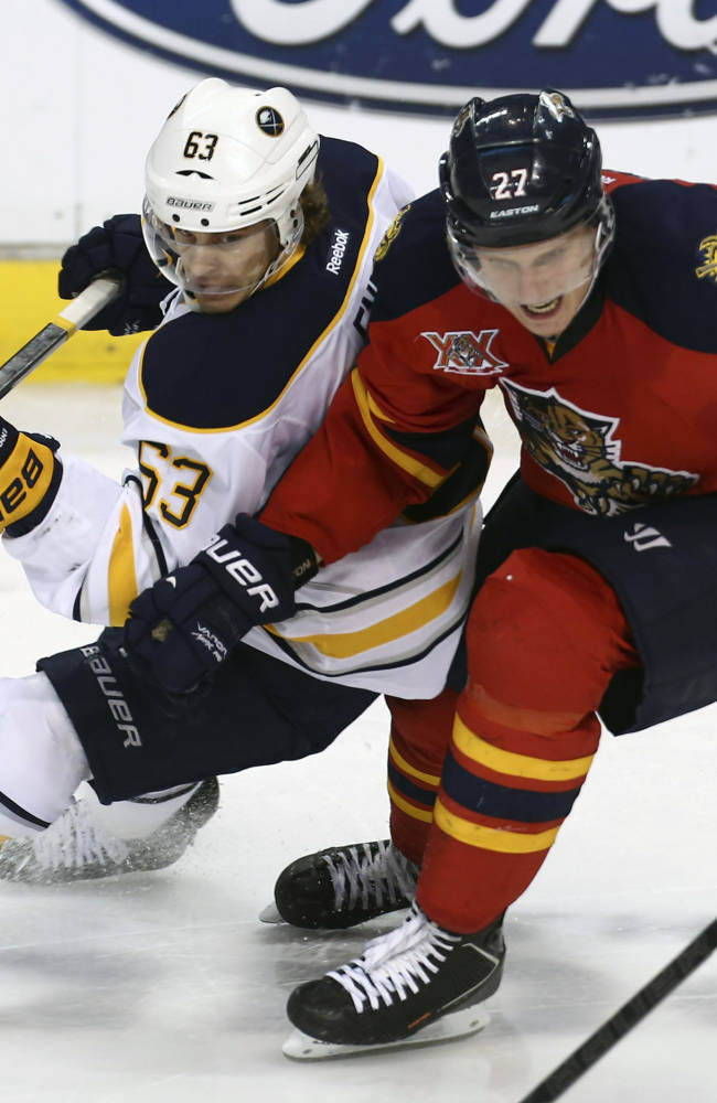 Buffalo Sabres' Tyler Ennis (63) and Florida Panthers' Nick Bjudstad (27) battle for the puck during the second period of an NHL hockey game in Sunrise, Fla., Friday, March 7, 2014