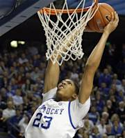 Kentucky's Anthony Davis (23) goes up for a dunk in front of Louisville's Gorgui Dieng during the second half of an NCAA college basketball game in Lexington, Ky., Saturday, Dec. 31, 2011. Kentucky won 69-62. (AP Photo/James Crisp)
