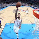 OKLAHOMA CITY, OK- DECEMBER 14: Perry Jones #3 of the Oklahoma City Thunder goes up for a shot against the Phoeniz Suns on December 14, 2014 at Chesapeake Energy Arena in Oklahoma City, OK. (Photo by Layne Murdoch/NBAE via Getty Images)