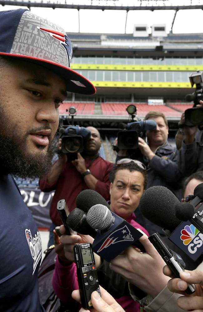 New England Patriots NFL football offensive lineman rookie Jon Halapio, left, speaks with members of the media on the field at Gillette Stadium, in Foxborough, Mass., Tuesday, May 13, 2014