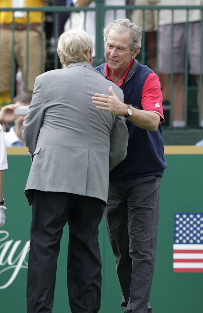 Former President George W. Bush, right, greets Jack Nicklaus on the first tee before the start of the four-ball match at the Presidents Cup golf tournament at Muirfield Village Golf Club Thursday, Oct. 3, 2013, in Dublin, Ohio