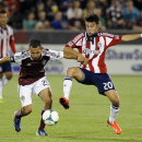 Colorado Rapids midfielder Pablo Mastroeni, left, of Argentina, fights for the ball against Chivas USA midfielder Carlos Alvarez, right, in the second half of an MLS soccer game in Commerce City, Colo., on Saturday, May, 25 2013. The Rapids won 2-0. (AP Photo/Chris Schneider)