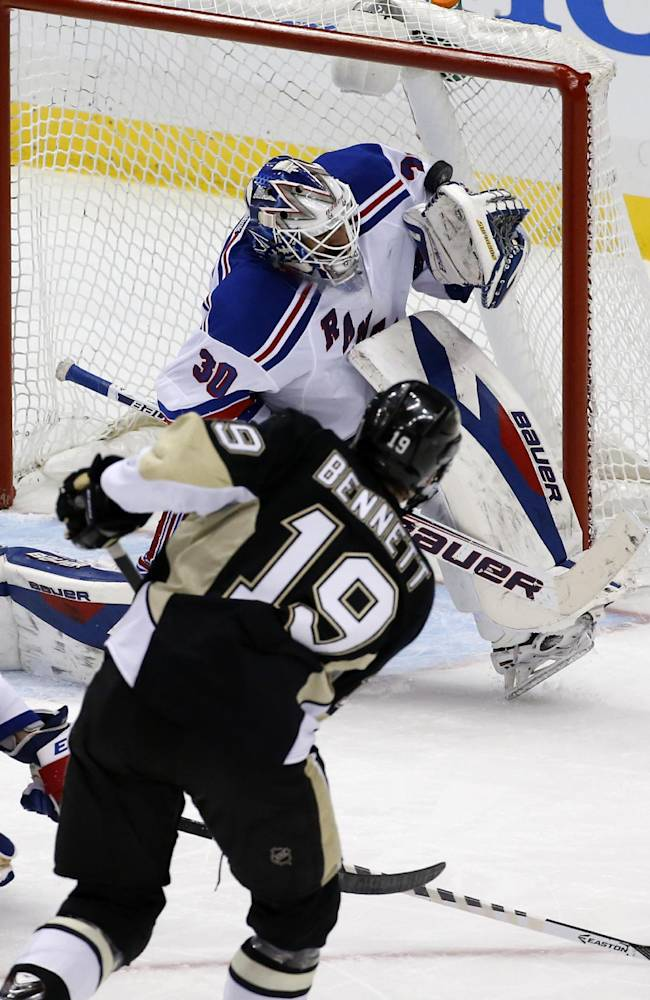 New York Rangers goalie Henrik Lundqvist (30) stops a shot by Pittsburgh Penguins' Beau Bennett (19) in the third period of game 2 of a second-round NHL playoff hockey series in Pittsburgh Sunday, May 4, 2014. The Penguins won 3-0, evening the series at 1-1