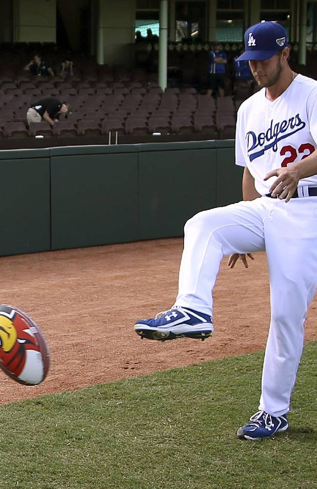 The Los Angeles Dodgers' Clayton Kershaw kicks a rugby league ball at the Sydney Cricket Ground in Sydney, Wednesday, March 19, 2014. The MLB season-opening two-game series between the Dodgers and Diamondbacks in Sydney will be played this weekend