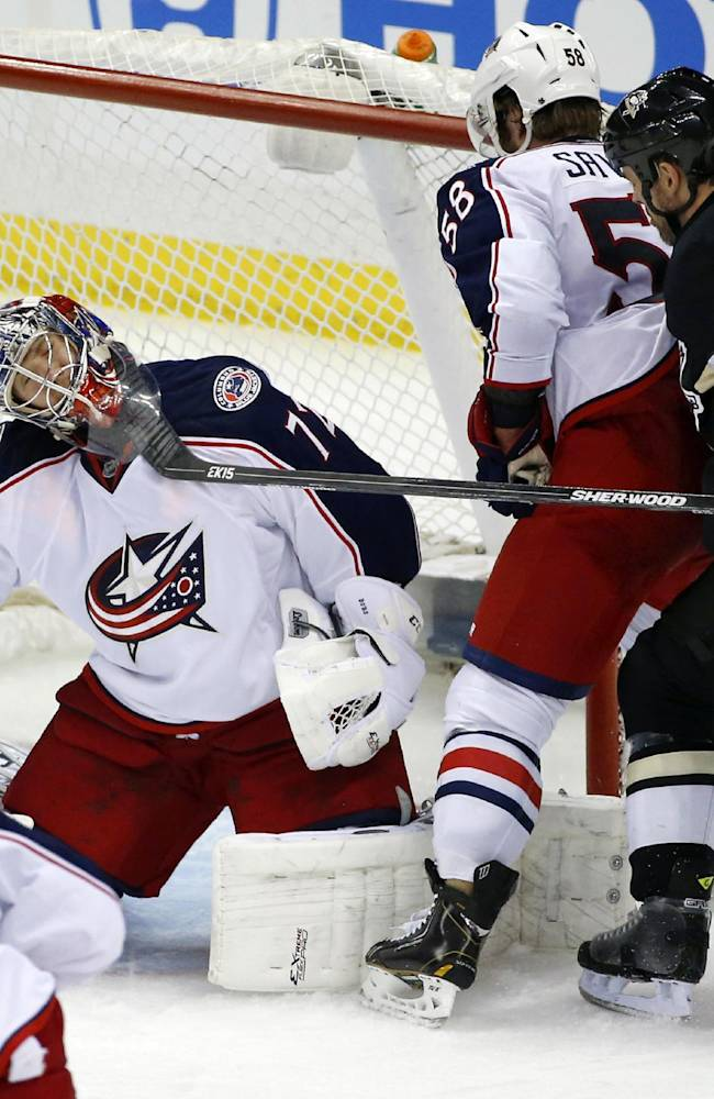 Pittsburgh Penguins' Craig Adams (27) gets his stick up under the mask of Columbus Blue Jackets goalie Sergei Bobrovsky (72) in the third period of a first-round NHL playoff hockey game in Pittsburgh, Saturday, April 19, 2014. Adams was penalized two-minutes for high-sticking