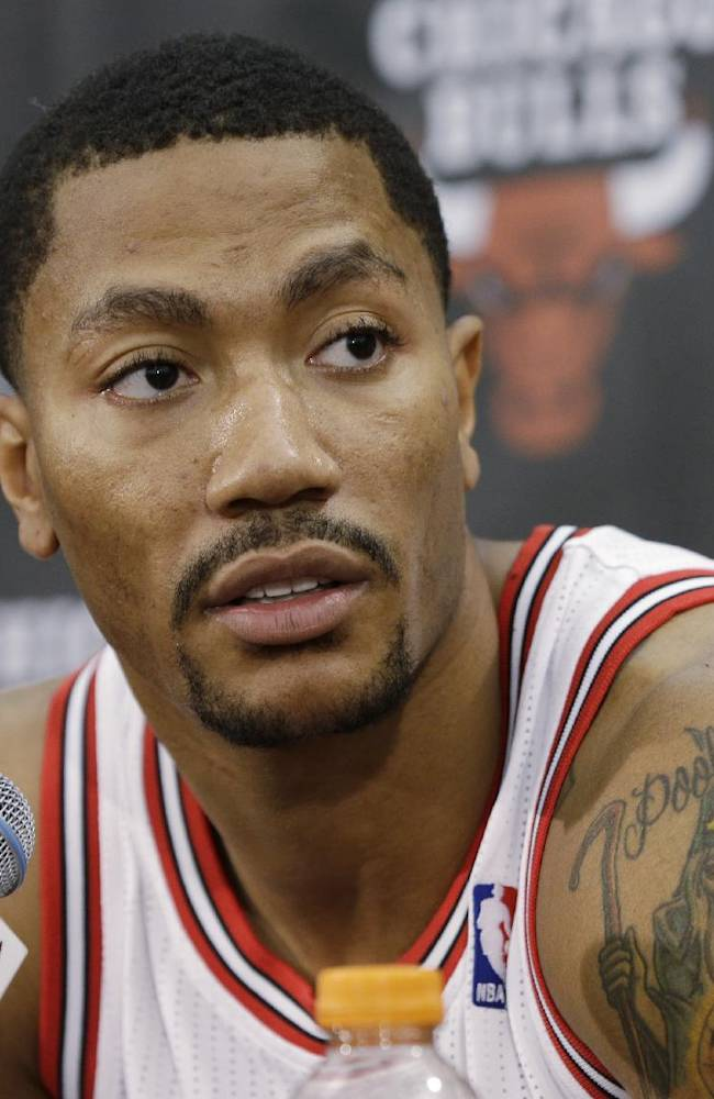 In this Sept. 27, 2013 file photo, Chicago Bulls guard Derrick Rose speaks during a news conference at the NBA basketball team's media day, in Deerfield, Ill. Rose is out for the season. The team said Monday, Nov. 25, 2013, that Rose had successful surgery to repair a torn medial meniscus in his right knee.  Rose was hurt Friday night, Nov. 22, 2013, at Portland