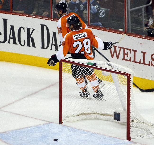 Philadelphia Flyers' Luke Schenn, left, and Claude Giroux skate behind the net after an empty-net goal by Pittsburgh Penguins' Evgeni Malkin late in the third period of an NHL hockey game, Thursday, Oct. 17, 2013, in Philadelphia. The Penguins won 4-1
