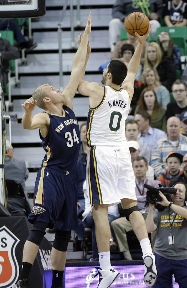 Utah Jazz's Enes Kanter (0) shoots as New Orleans Pelicans' Greg Stiemsma (34) defends in the first quarter during an NBA basketball game on Friday, April 4, 2014, in Salt Lake City
